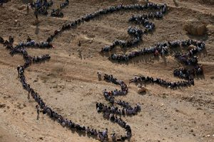 aerial photo of Palestinian students forming the outline of a peace dove